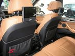 65-12-2-160-229BMW E61 -  DVD system -Tablet- retro fit kit behind the neckrests (wireless headphones can be bought in addition) including remote control org. BMW
