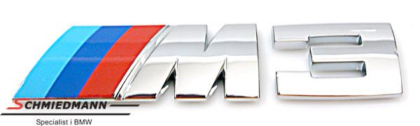 Emblem M3 påklæbes